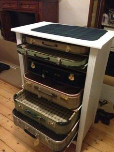 Up cycled end table and suitcases
