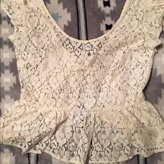 Lace peplum shirt Size small, bought at urban outfitters and never wore. Sheer lace peplum shirt, it's cropped in the back and has a V back. Super cute! Feel free to send me offers! Urban Outfitters Tops Crop Tops