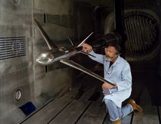 NASA technician W.L. Jones inspects a transport model Pathfinder I between test runs at Langley's National Transonic Facility (NTF). The stainless steel model is representative of the next generation of subsonic transports. With the help of super-cold nitrogen and high pressure, the NTF is the first major wind tunnel that can simulate full scale aerodynamic flight conditions.