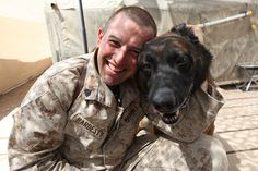 "Sgt. Charles D. Hardesty, combat tracker dog handler, Military Police, I Marine Headquarters Group, I Marine Expeditionary Force (FWD), bonds with his dog, Robbie or also known as ""bear"" at Camp Leatherneck, Afghanistan. ""Robbie loves attention,"" says Hardesty. ""He is a nutcase."" Hardesty and Robbie have been together for two years and both have a constant flow of energy."