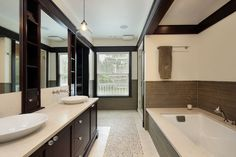 Modern Master Bathroom with frameless showerdoor, limestone tile floors, Shaker Cabinetry, Cabinet Now, Double sink, Flush