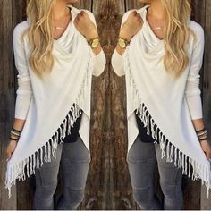 White fringed tassel top asymmetrical White fringed tassel/fringe sweater (red pic used to show without her hand over the button - I also have this in red btw!), super cute! Asymmetric hem, button closure by the shoulder. Size chart shown above, as you can see although the size is marked XL it runs a little smaller than that, more like a large, so please size accordingly. The style is like a cardigan sweater but the material is more like a tshirt. I bought this shirt in 3 colors, love in in…