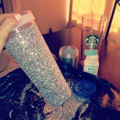 Glittering my customizable starbucks cup! Martha Stewart glittering glue, 2-3 oz of glitter and the starbucks cup insert. Paint on glue, roll/sprinkle in glitter, let dry, screw insert back into cup!