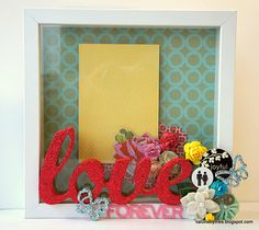 An altered frame with Maya Road blossoms, mini chipboard butterflies and Cherry Red glitter!