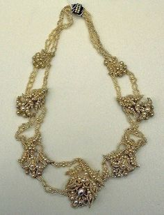 Pearl necklace with baroque floral design, European, 1860-65. Part of a jewelry set, along with a pair of pearl pendant earrings with screw backs.