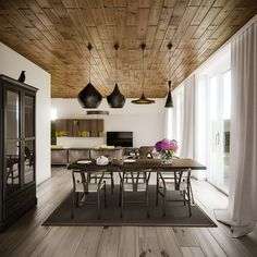 industrial style dining room with dark wood panels on ceiling, black table and chairs, white cabinet