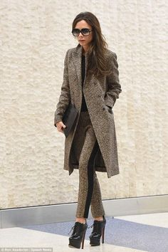 Victoria Beckham wearing Alaia Lace-Up Leather Booties and Victoria Beckham Pre-Fall 2016