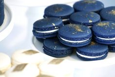 Navy french macarons w/ gold dust splatter