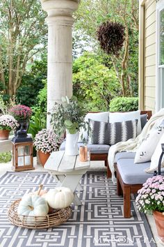 fall porch decorating with neutral accents and pale pink mums