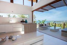 Open plan living and kitchen with modern tropical style