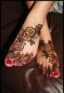 foot tattoo- I like how this one moves across the foot. The toes are a bit much for a real tattoo.