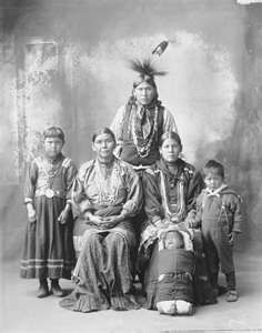 """Kickapoo Indian family - Kickapoo (Kiikaapoa or Kiikaapoi) are an Algonquian-speaking Native American tribe. According to the Anishinaabeg, the name """"Kickapoo"""" (Giiwigaabaw in the Anishinaabe language and its Kickapoo cognate Kiwikapawa) means """"Stands here and there"""". It referred to the tribe's migratory patterns. The name can also mean """"wanderer""""."""