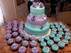 Turquoise and Purple Quinceañera cake with matching cupcakes