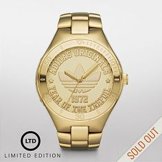 adidas Originals.....This watch features a gold-tone stainless steel case and bracelet. A coin-stamped dial with polished details completes the look.