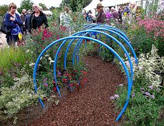 Miniature Garden, with Blue Hoops over the path, Wisley Flower Show 8 9 Wisley Flower Show 8 9 11 How simple, and Fun! Blue Hoops over the path, Wisley Flower Show 8 9 Wisley Flower Show 8 9 11 Outdoor Play Spaces, Kids Outdoor Play, Backyard Play, Kids Play Area, Backyard For Kids, Outdoor Learning, Kids Fun, Natural Playground, Outdoor Playground
