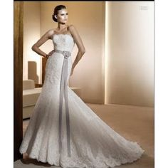 This wedding dress is driving me crazy ! Of course the girl wearing it is very good looking but i might as hot as her hehehehe