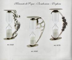 """Mercante di Sogni - Voghera - Bomboniere e Stampati dal 1969 - Vendita ai privati: Collezioni ITBRI: Articoli in argento - Clessidre classiche e smaltate  Collezione """"ITBRI"""" CLESSIDRE CLASSICHE E SMALTATE Articoli in argento IPPOCAMPO - CUORI - MARGHERITE COCCINELLE - UVA - FIORI - LAUREA H. 9,50 cm  Read more: http://mercantedisognivoghera.blogspot.com/2015/08/collezioni-itbri-articoli-in-argento_18.html#ixzz3jBHGPvkh"""