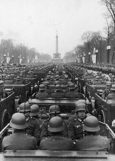 A general view German Soldiers in jeeps with the newly placed victory column in the background in Berlin circa 1940s