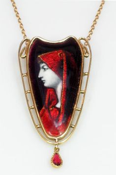 Early twentieth century ladies limoges enamel pendant featuring a woman wearing a veil, set in 18ct gold, pendant signed 'Issanchou' Circa 1900 - 1910.