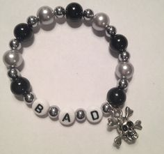 Awesome handmade stretch beaded black and by DDsSassyAccessories, $4.00