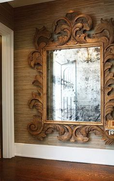 huge, carved mirror + grasscloth