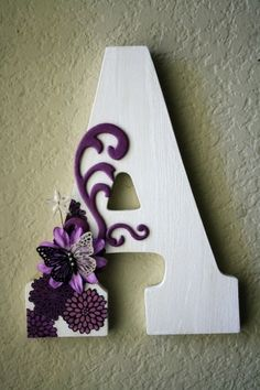 paint letter white use purple puffy paint for scrollwork add small purple flower and butterfly use small flower stencil in corner