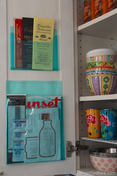 Use adhesive pockets on cupboard doors for a better way to organize coupons, loose recipes and takeout menus.