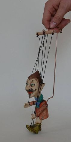 The pocket home elves can protect your home or follow you on your travels and bring you luck. Itll make an original gift for your friends or for your loved ones. Operating device: wire and strings Puppet weight: 100 g / 0.25 lb Height: 3 in Height of puppet with controller: 9 in Material: Clay Clay puppets are a good compromise of gypsum and wooden ones. Their price is more friendly than that of the wooden ones and the material is much stronger than gypsum. They are not heavy becau...