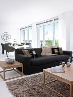 living room with black couches - more of the same, I\'d like more ...