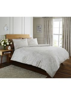 Bring Sophisticated Luxury To Your Home With Our Life From Coloroll Range The Lara Chambray Ruffle Duvet Cover And Pillowcase Set In White Feature
