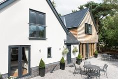 Oak Frame House Available to View in Cheshire Got full length windows at front. But I don't think front main entrance is obvious enough Oak Cladding, House Cladding, Oak Frame House, A Frame Cabin, Rendered Houses, Bungalow Renovation, Exterior Remodel, House Goals, House Front