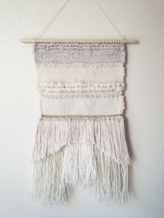 White and cream handwoven wall tapestry with some gold thread measures inches by 18 inches at longest point of weaving. Wooden dowel is 12 inches long. a mix of wool, cotton and linen Perfect for your home or office Weaving Textiles, Weaving Art, Loom Weaving, Tapestry Weaving, Wall Tapestry, Hand Weaving, Weaving Wall Hanging, Wall Hangings, Deco Boheme
