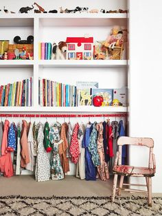 Books, toys, heirloom, and a few favorite statement outfits double as décor in this chic children's closet. Create a sense of rich history and soulful cool by peppering vintage...