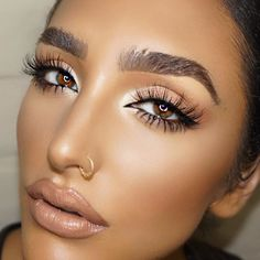 Bronze glowing makeup with glossy nude lips & lashes