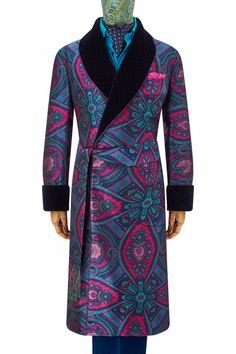 Handmade in England, this stunning gown uses 300 end pure English silk to give its design a lustre and weight which denotes its excellent pedigree. It is fully lined in a rich two-tone turquoise and fuchsia satin and has hand-quilted velvet revers, gauntlet cuffs and patch pockets. It is piped throughout.
