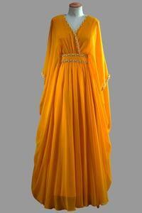 Queen Elizabeth II, a dress by Norman Hartnell