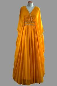 Queen Elizabeth II, a 1970s dress by Norman Hartnell I would totally rock this.