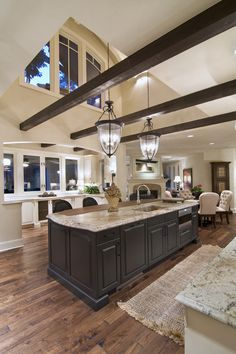 Wood beams, white kitchens and marble backsplash, a perfect combination.
