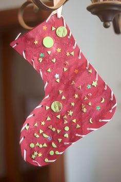 Jazz up a classic Christmas stocking craft with some glitter and stickers!