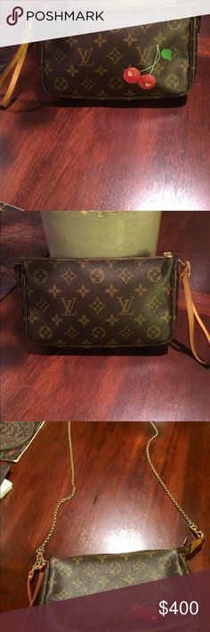 """Louis Vuitton Pochette Authentic Louis Vuitton Pochette with Double Cherries has a wrist strap in Great condition It Measures 8.5""""x 11.5""""x 2.5"""" comes with an extra Gold Chain to carry on your shoulder Louis Vuitton Bags Clutches & Wristlets"""