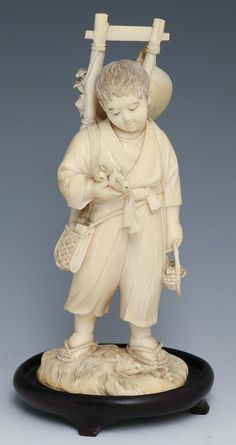 """JAPANESE CARVED IVORY OKIMONO YOUNG BOY W BIRDS Japanese carved ivory okimono figure, late 19th/early 20th C., young boy with birds carrying a ladder. Signed on underside, includes base. Provenance: Private Minnesota estate. Weight: 210g without base Size: 6.25"""" without base"""