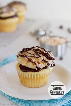 Samoa Cupcake - a yellow cupcake filled with caramel and topped with chocolate ganache, caramel buttercream and toasted coconut | www.tasteandtellblog.com