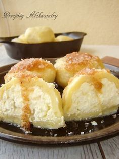 KNEDLE Z SEREM NA SŁODKO------------ 700 gr potatoes, boiled and milled c flour cup potato flour 1 egg salt pound cottage cheese 1 tbs butter, soft 1 egg yolk 1 tablespoon sugar butter and bread crumbs+ sugar for sprinkling Polish Desserts, Polish Recipes, Polish Food, Sweet Recipes, Cake Recipes, Dessert Recipes, European Dishes, Tasty, Yummy Food
