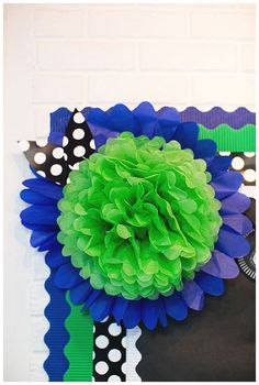 Pom pom on top of paper daisy with multiple borders bulletin boards display Polka Dot Classroom, Classroom Design, Classroom Displays, Classroom Themes, School Classroom, Classroom Organization, Holiday Classrooms, Classroom Crafts, Library Displays
