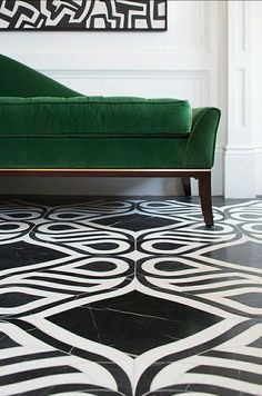 a pop of emerald velvet is the perfect complement to graphic black + white tiling