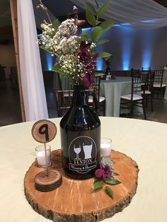 Outdoor Weddings Growlers used for a table centerpiece . Brewery wedding, rustic, outdoor theme in Fenton Michigan. Beer Bottle Centerpieces, Rustic Wedding Centerpieces, Flower Centerpieces, Wedding Decorations, Wedding Rustic, Quinceanera Centerpieces, Centerpiece Ideas, Craft Beer Wedding, Wedding Crafts
