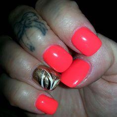 Neon orange with design on ring finger