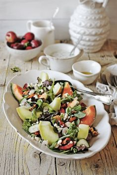 Melon salad with plums, green leaves, cucumber, seafood, feta and lemon, mint, yogurt sauce | Pratos e Travessas