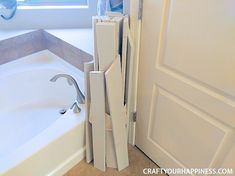 If you have a bathtub or garden tub you don't use often, learn how to increase your space by making a beautiful inexpensive removable wood bathtub cover. Bathtub Shower Combo, Bath Tub, Anew Gray Sherwin Williams, Contact Paper Countertop, Bathtub Cover, Wood Bathtub, Large Tub, Window Benches, Tub Cleaner