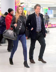 Happy days: Hugh Grant is reportedly set to become a father for the fifth time, after his girlfriend Anna Eberstein's mother confirmed their happy news shortly before they were seen touching down in NYC after the Golden Globes Jennifer Grant, Jennifer Hudson, Hugh Grant Children, Airport Attire, Candace Cameron Bure, Travel Chic, Becoming A Father, Elizabeth Hurley, Gary Oldman